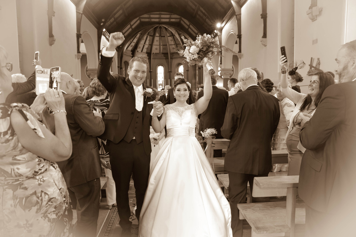 Bride & Groom walking down aisle