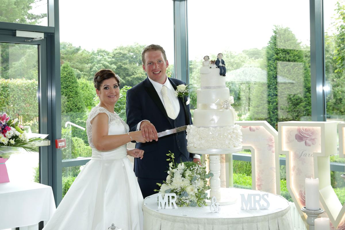 Bride, Groom & Wedding Cake